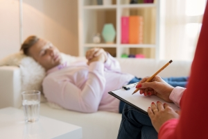 Man Lying In Couch During Hypnotherapy