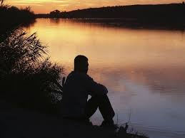 Man Sitting By A River